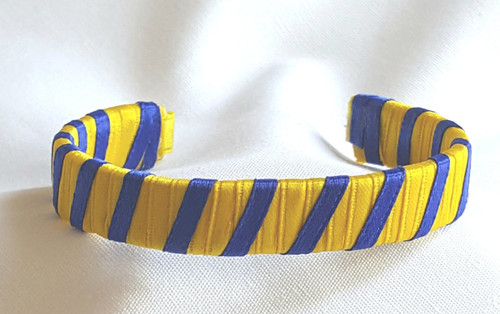 Show off your School Colors by wearing our Yellow and Blue Ribbon Cuff Bracelet.  Aluminum base with creatively decorative wrapped ribbon.  Perfect for individual inspiration, school groups/events, donation requests and for whatever your creative imagination brings.