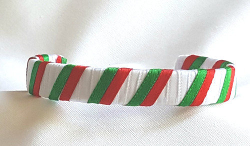 Show off your Holiday Spirit by wearing our Red and Green over a layer of white Ribbon Cuff Bracelet.  Aluminum base with creatively decorative wrapped ribbon.  Perfect for individual inspiration, school groups/events, donation requests, stocking stuffer and for whatever your creative imagination brings.