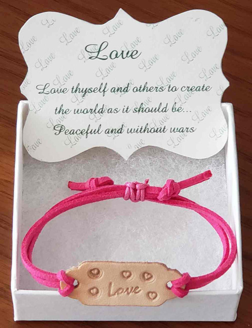 Handcrafted with hand stamped leather link Bracelet.  The leather link color may vary due to supplied shading. Adjustable suede band