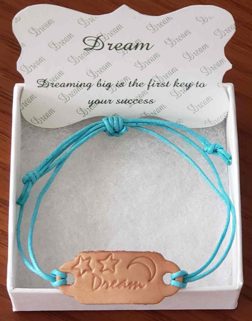 Handcrafted with hand stamped leather link Bracelet.  The leather link color may vary due to supplied shading. Adjustable cotton braid cording band