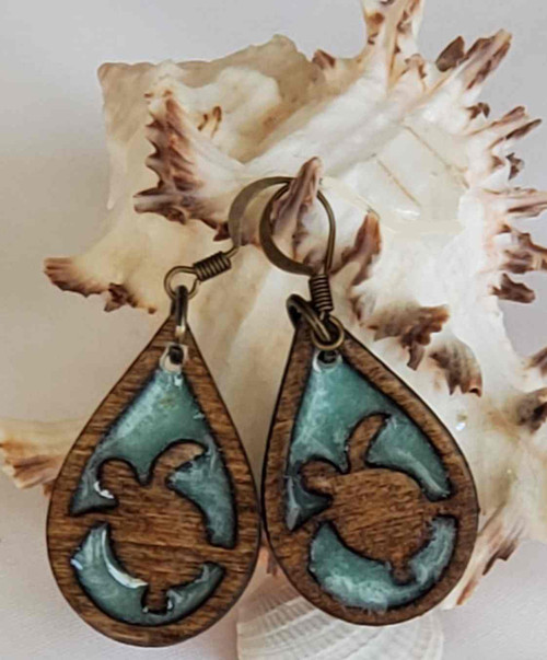 Beautiful Turtle tear drop earrings with sea green epoxy fill giving the appearance of the turtle swimming in the water.