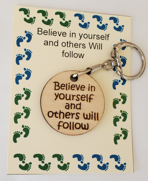 Custom made round wooden laser engraved key chain that can be turned into a pocket coin as well