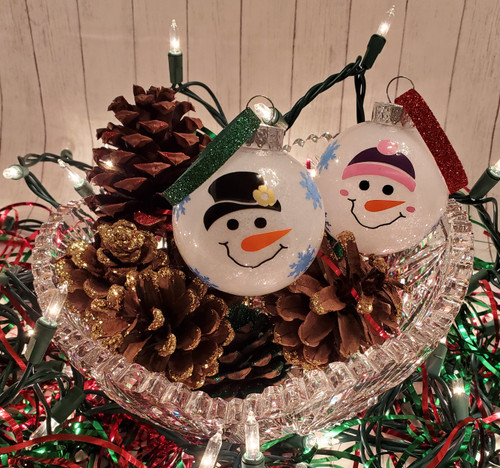Personalized tree ornaments (plastic). Girl and boy snowmen ornaments with 2020 on back.