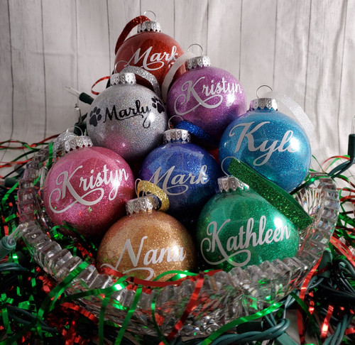 Personalized tree ornaments (plastic). Your choice of glitter color and ribbon color.  Has year 2020 on back. Ornament glitter choices: Gold, Multi-colored glitter, Purple, Turquoise,  Green, Pink, Blue, Red. Ribbon Choices: Red, Green, Blue, Silver, Gold