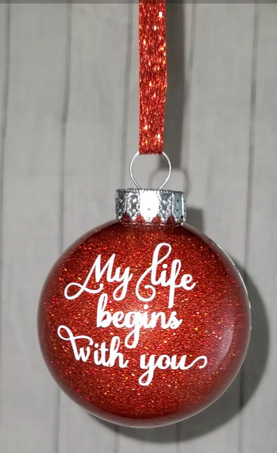 Our newest ornament. The beginning year you met on the left side to the current year on the right. Both names on the back.