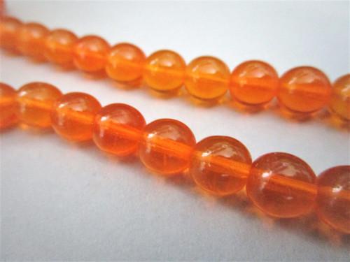 Hyacinth orange 8mm round druk Czech glass beads