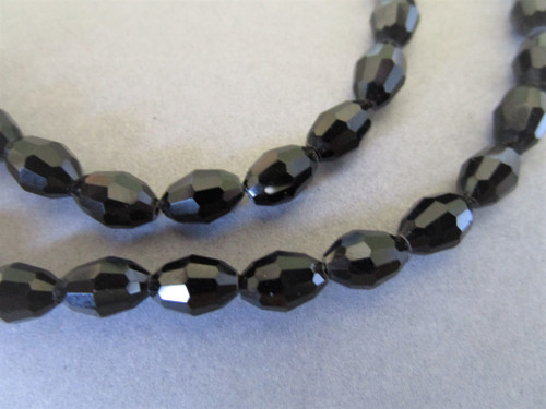 Faceted oval glass beads