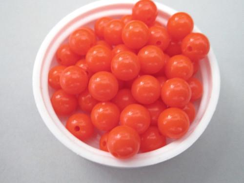 Opaque orange 8mm round vintage lucite beads