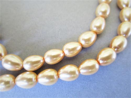 Light orange 9x7mm teardrop glass pearl beads