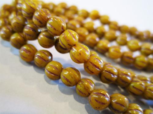 Opaque yellow brown wash 4mm melon Czech beads