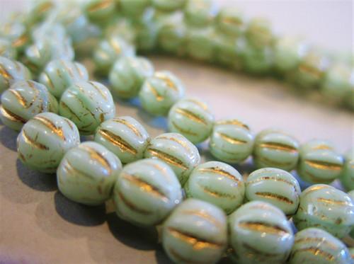 Opaque mint green gold wash 4mm melon Czech beads