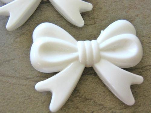 Opaque white 46mm bow bead acrylic