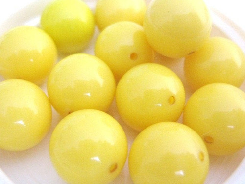 Opaque yellow 11mm round vintage lucite bead