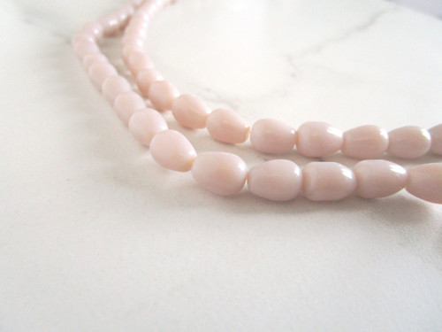 Opaque beige 11x8mm teardrop glass beads