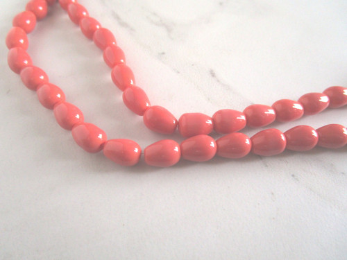 Opaque coral 11x8mm teardrop glass beads
