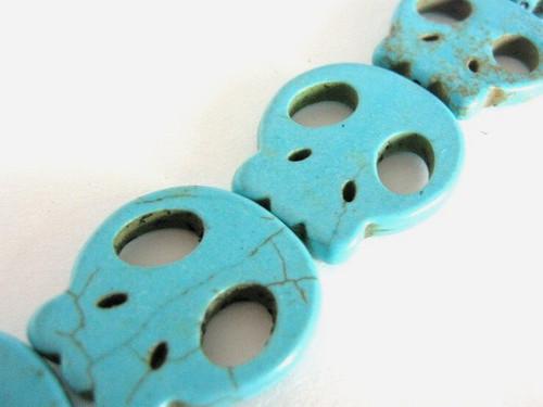 Turquoise howlite skull gemstone bead