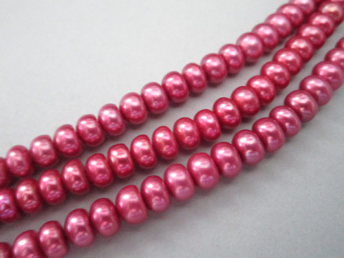 Pink button freshwater pearl beads