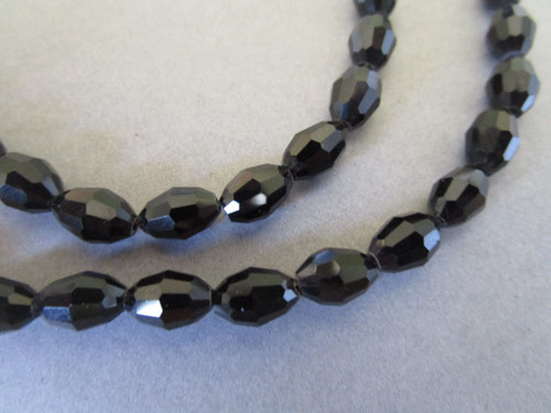Black 8x6mm faceted oval glass beads
