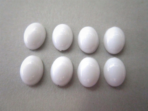 Opaque white 10x14mm oval cabochon vintage lucite