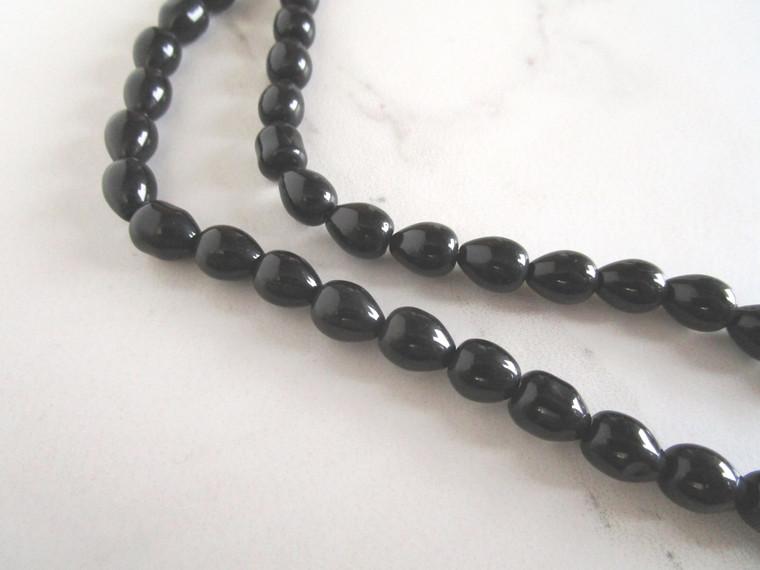 Black 11x8mm teardrop glass beads