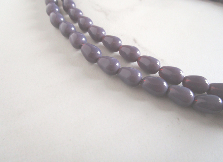 Opaque purple 11x8mm teardrop glass beads