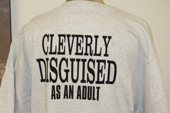 CLEVERLY DISGUISED AS AN ADULT on a Grey Shirt.