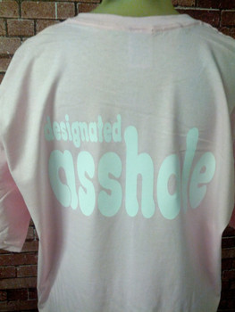 Designated Asshole on a pink Shirt.