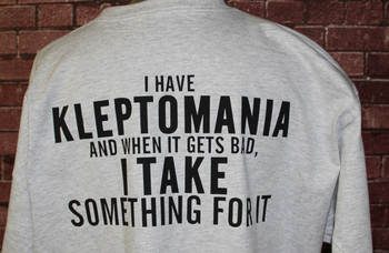 I HAVE KLEPTOMANIA AND WHEN IT GETS BAD, I TAKE SOMETHING FOR IT ON A GRAY SHIRT