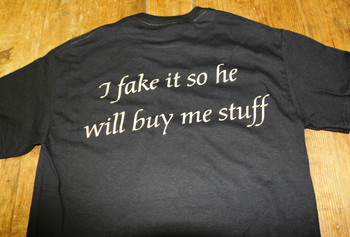 click here to add a descriptionI fake it so he will buy me stuff T-Shirt