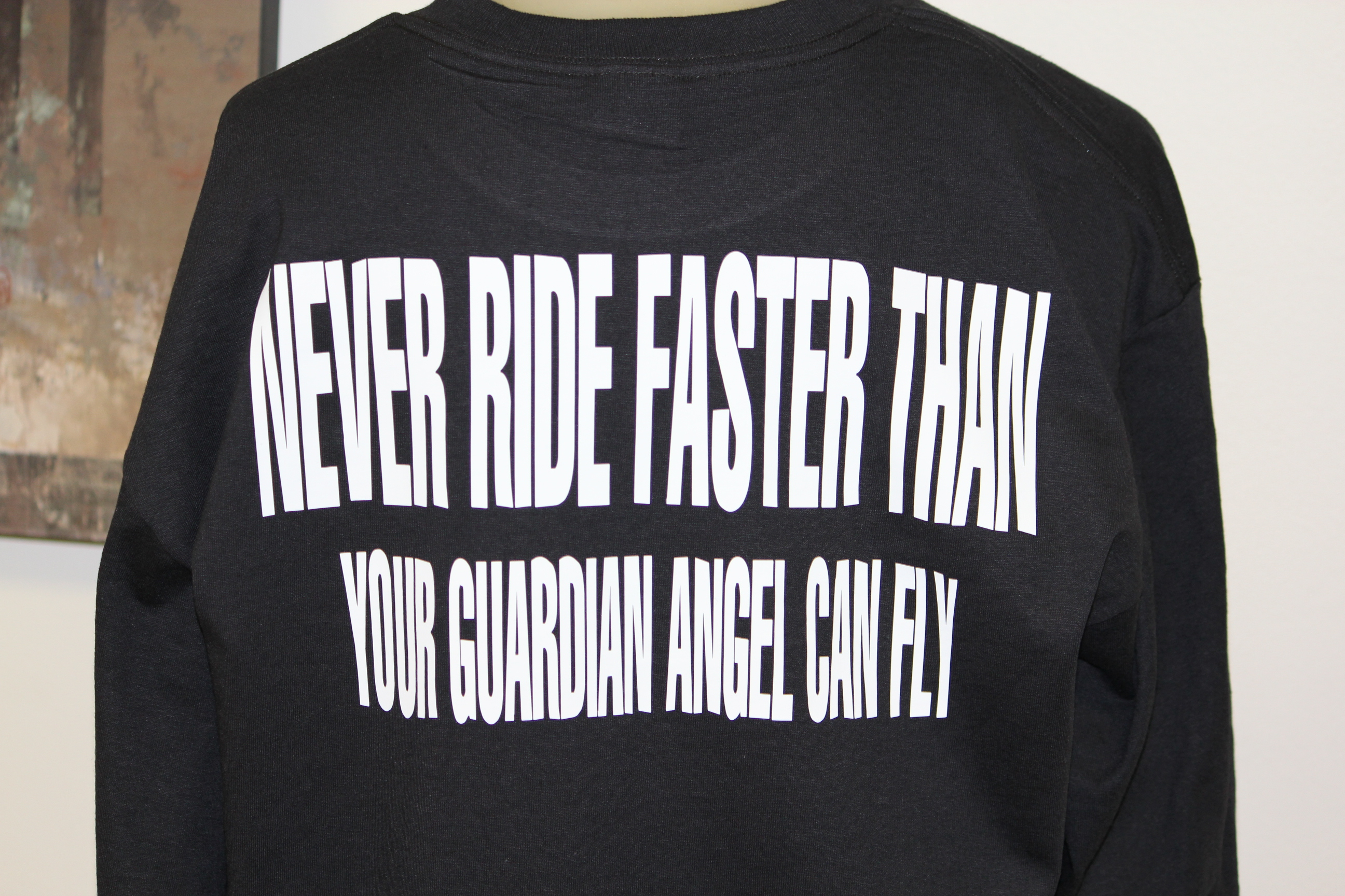 never-ride-faster-than-your-guardian-angel-can-fly-biker-t-shirts.jpg