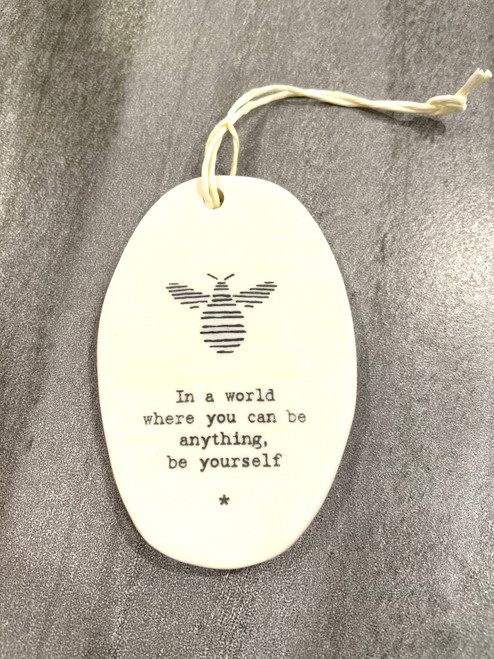 """Inspirational porcelain hanging plaque. """"In a world where you can be anything be yourself"""""""
