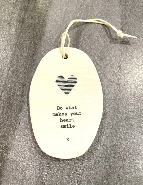 Porcelain hanging plaque with sentiments inscribed on front.