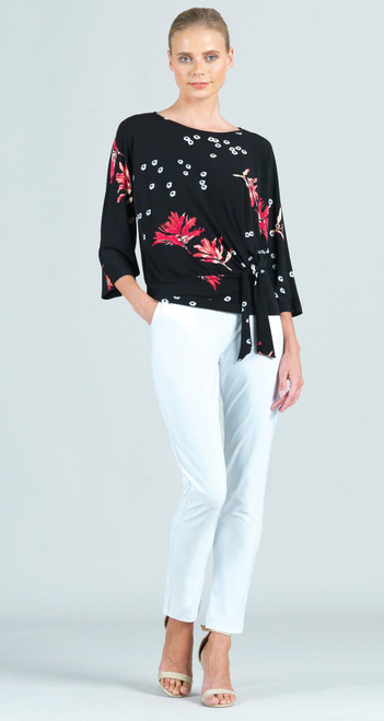 """Allow our Floral Flake Print Side Tie Top, help your wardrobe to blossom! Featuring a high round neckline, 3/4 length sleeves, built-in side tie waist hugging hemline that accentuates the hips, and an elegant blouson body effect that provides plenty of breathing space.  A print featuring a cascading cluster of white circle flakes, paired with crimson-colored flowers with subtle hints of coral against our signature black fabric.  ♥ Each piece is a unique, one-of-a-kind print and print placement will vary.   Carefree Travel Fabric - Soft Silky Knit Made from our signature soft stretch poly blend fibers. Easy care, quick-drying, and cooler than linen or cotton.  Size & Fit Model is 5'9"""" wearing extra small Designed to fit true to size  Product Details  Color: Black Crimson Fabric Content: 70% Polyester, 20% Rayon, 10% Spandex Made in the USA and designed in New York"""