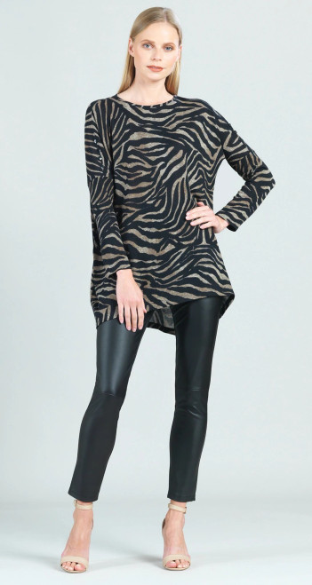 """You'll never want to change these stripes wearing our Lightweight Cozy Zebra Print Button Sleeve Boyfriend Sweater Tunic! Featuring a round neckline, long dolman sleeves with charming button detailing on the upper arm, and a slight high-low hemline with a left-side vent.  A neutral lovers dream, this print is comprised of warm taupe zebra stripes, against a black background.  ♥ Each piece is a unique, one-of-a-kind print and print placement will vary.   Lightweight Cozy Sweater Knit Our cozy sweaters are made from a lightweight soft textured knit and are ideal for layering without getting too warm. Made from Poly-Blend fibers making it easy to care for and travel friendly.  Travel Friendly Lightweight Sweater Knit Soft Cozy Texture  Size & Fit  Model is 5'9"""" wearing extra small Designed to fit loose and oversized with generous body room *Recommended to size down if you prefer a standard fit.   Product Details  SKU# TU114WP6 Color: Zebra Fabric Content: 70% Polyester, 20% Rayon, 10% Spandex Made in the USA, Designed in New York"""