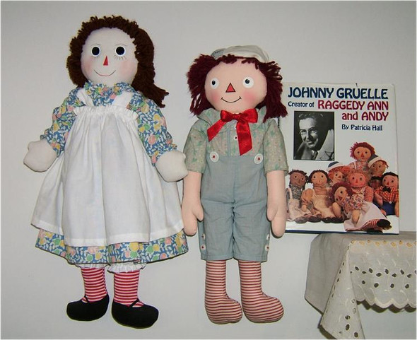 My reproduction Raggedy Ann doll designed and made to depict one of Johnny Gruelle's original designs depicted in the book. She is on page 113.    The Raggedy Andy is a commercially made Andy made by permission of the Gruelle family. The book is hardback