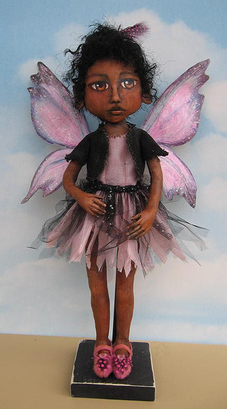 """Another wonderful 16"""" painted fairy with beautiful tyvek wings and a fringed tulle and fabric skirt."""