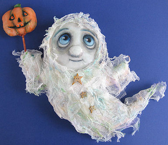 """This not-too-scary 13"""" ghost dressed in stiffened cheesecloth is holding a painted pumpkin wand."""