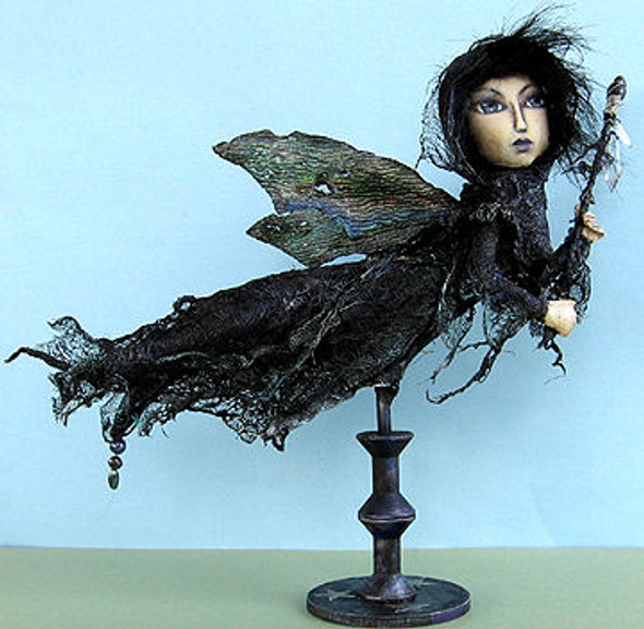 """This 15"""" painted fabric doll with stiffened cheesecloth dress is attached to a wood stand, has fun fur for hair, organza wings and a wand with crystal drops."""