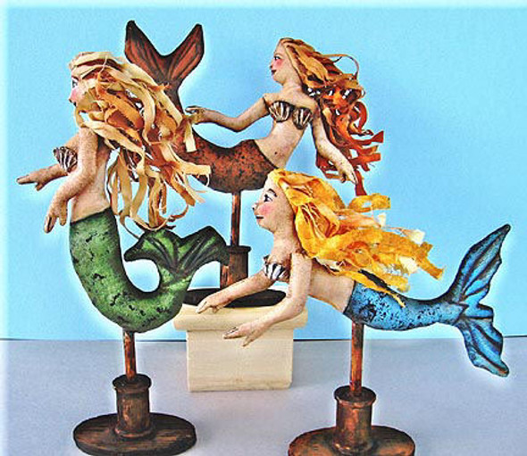 """You'll be stiffening fabric strips to make the hair for these darling 6"""" painted mermaids."""