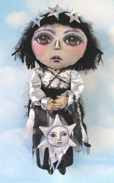 """This 14"""" painted muslin doll with her cloth star is a child of the Universe."""