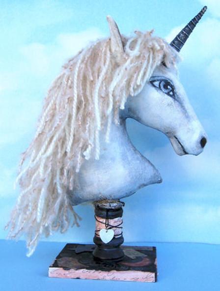 "Beautifully painted 12"" unicorn head with yarn mane."