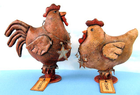 """9"""" painted rooster and 7"""" hen with quilted wings and tail adorned in rusted wire necklaces."""