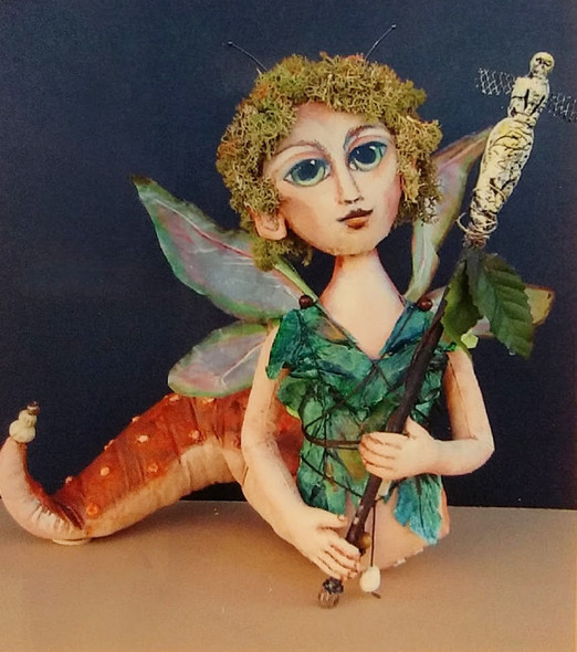 """Reigning over her Compost Kingdom this exotic 10"""" creature had silk wings, moss hair, a tyvek blouse and a puff painted tail."""