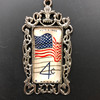 July 4th Vintage 1960 Stamp  Wear a pice of history with this amazing pendant made from an authentic vintage stamp. The silver setting and 24 inch chain are a perfect complement.
