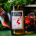 Wine Bottle Candles for the Holidays.  This Soy candle is set in a hand-cut recycled wine bottle and is part of a green initiative dedicated to environmental responsibility, freshness, and quality.  Made by Tipsy Candle Company.