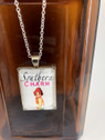 Southern Charm Rectangle pendant necklace with heart charm.