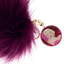 Marilyn Monroe Comic Image Pendant keychain surrounded in pink glitter with an oversized Pom Pom key chain.