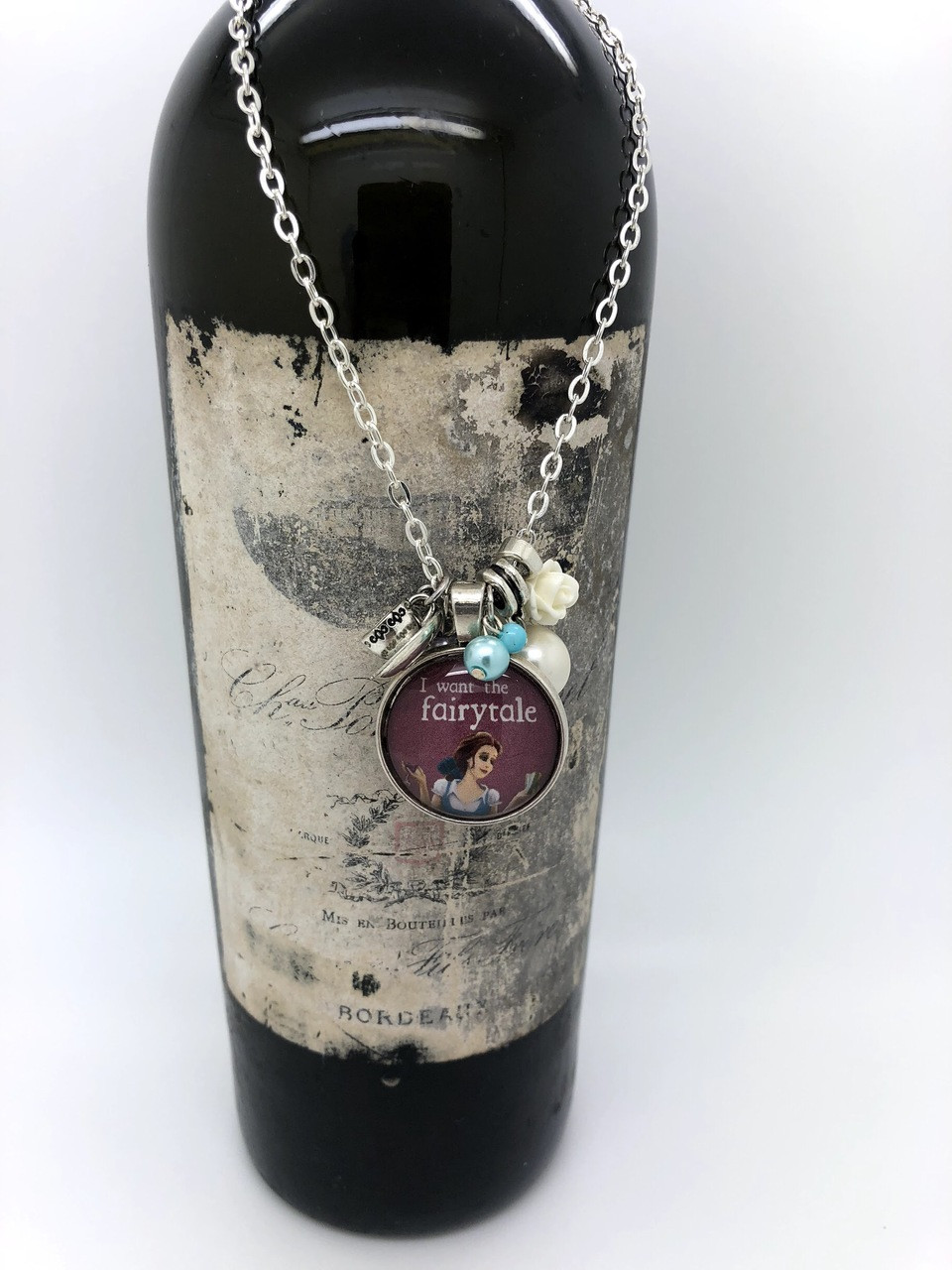 I want the fairytale  Belle Chérie 24 inch round pendant necklace  The tea cup and flower charm finish off this enchanted necklace. Charm is 1 inch. Round.