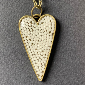 White pearlized sprinkles heart chain necklace, set in vintage bronze sprinkles Pendant is 4in 29in matching chain.