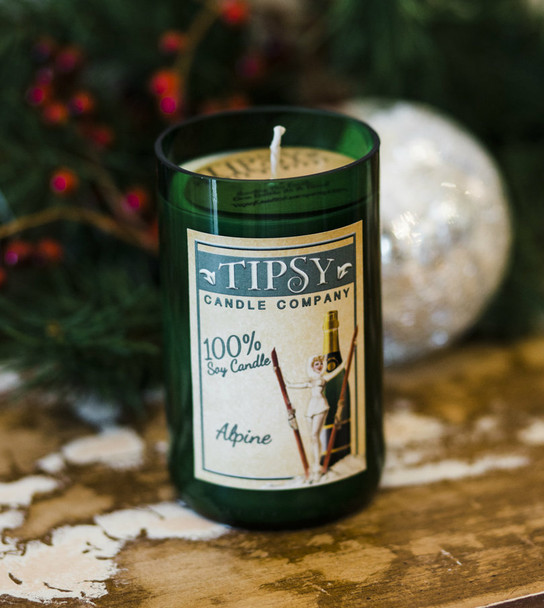 Alpine 100% soy candle is set in a hand-smoothed recycled wine bottle.  14 ounce candle in recycled wine bottle with 100% Soy and essential oils.  Burn time approximately 60 hours.